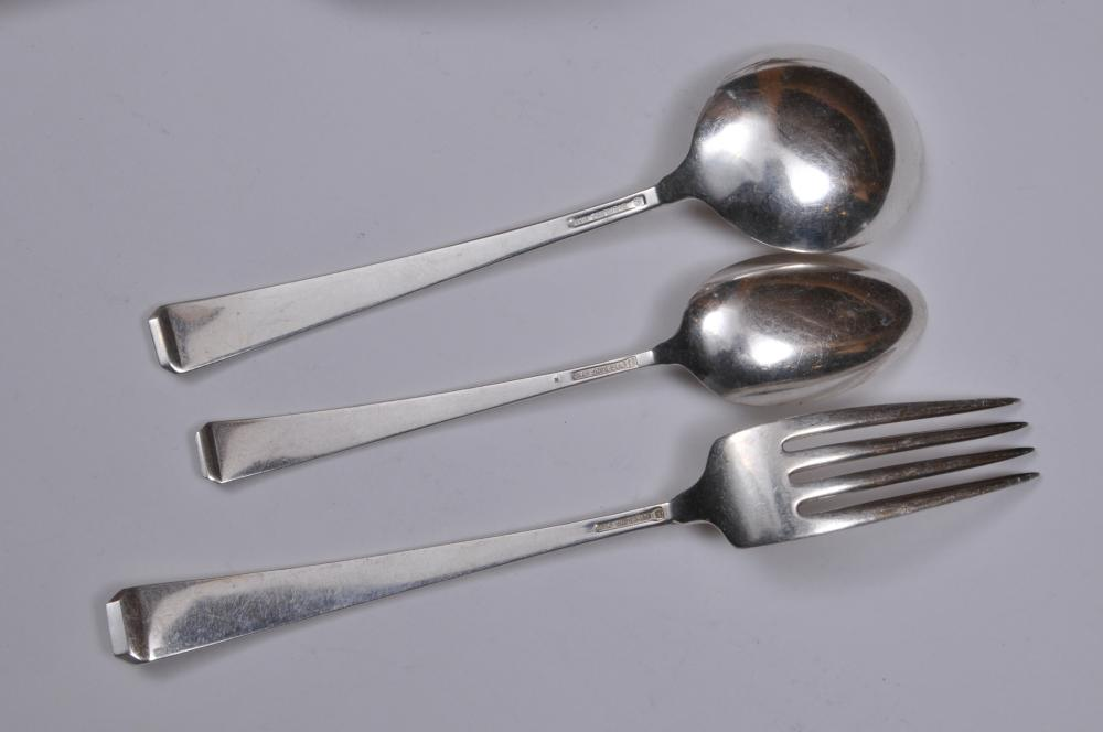 """Lot 133: Craftsman sterling silver Arts and Crafts. 22 flatware pieces. Includes: (5) cream soup spoons- 6-1/4"""". (5) forks- 7-1/4"""". ( 5) teaspoons- 6"""". (2) scoop spoons- 5-3/4"""". (1) pickle fork. (2) tablespoons- 8-1/2"""". (1) large serving spoon- 8"""". (1) large"""