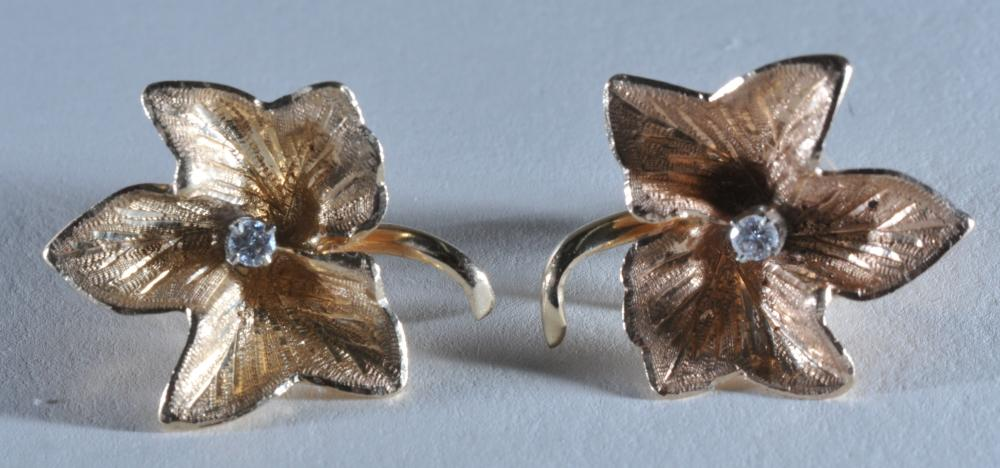 Tiffany and Co. 14 karat rose gold leaf form diamond mounted earrings.  9.2 grams.
