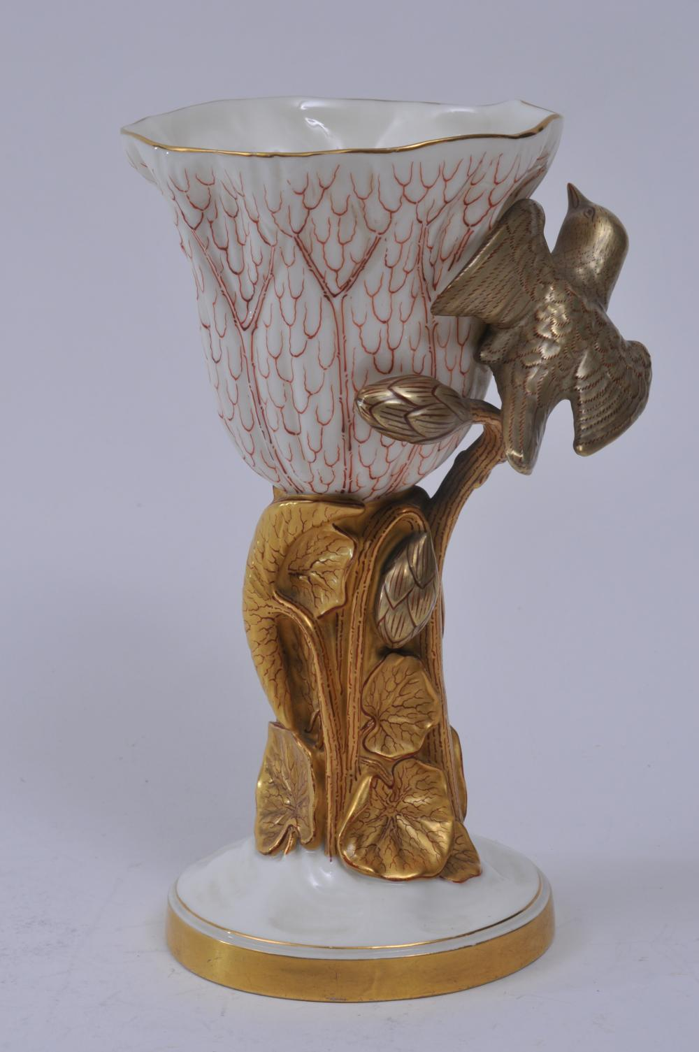 """Lot 180: Royal Worcester porcelain gilt decorated chalice with large relief bird and lily pad decoration. Signed on base. 7-1/2"""" high. Good condition. Wear to gilt on base trim."""