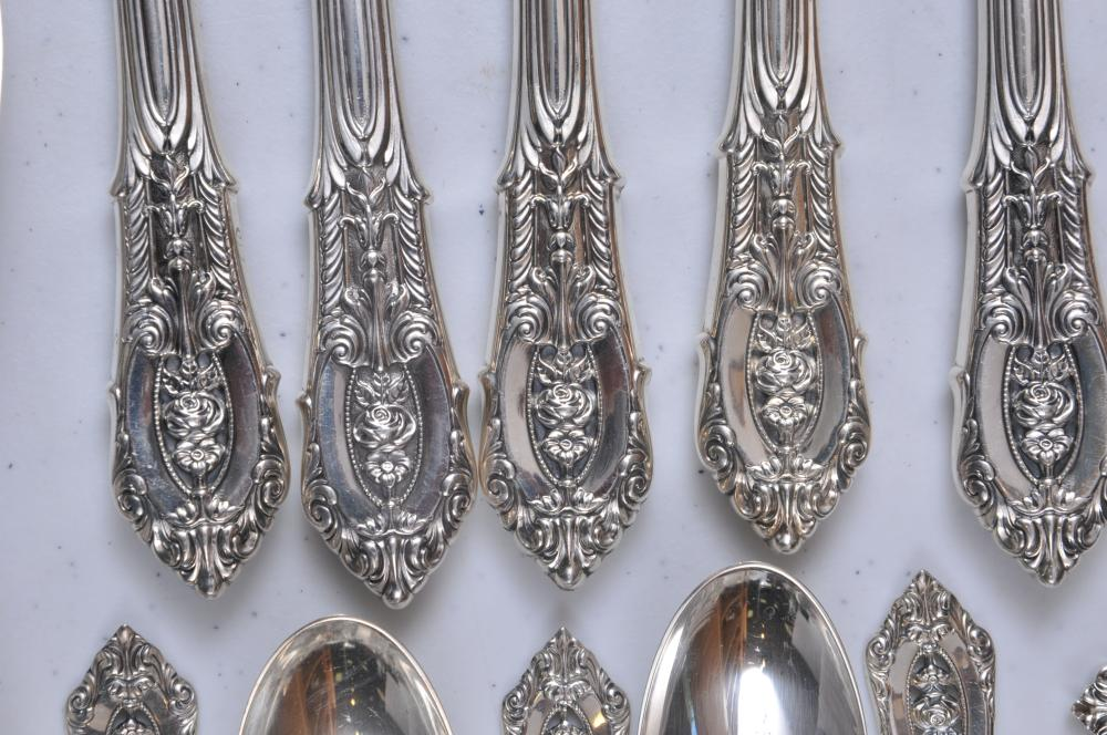 """Lot 178: Wallace """"Rose Point"""" 122 piece sterling silver flatware set. Includes: (12) knives- eleven at 9-3/4"""" one at 9-1/4"""". (12) butter knives- 6-1/8"""". (12) ice tea spoons- 7-5/8"""". (19) teaspoons- 6"""". (10) cream soup spoons- 6"""". (12) salad forks- 6-1/4"""". (11"""