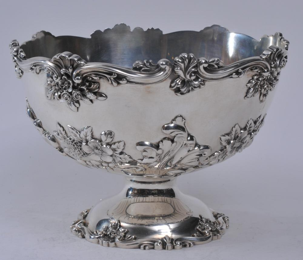 """Durgin sterling silver large footed compote with floral repousse decoration, raised leaf and scroll borders. Good condition. 8-3/4"""" diameter. 6-1/4"""" high.  31.1 ozt."""