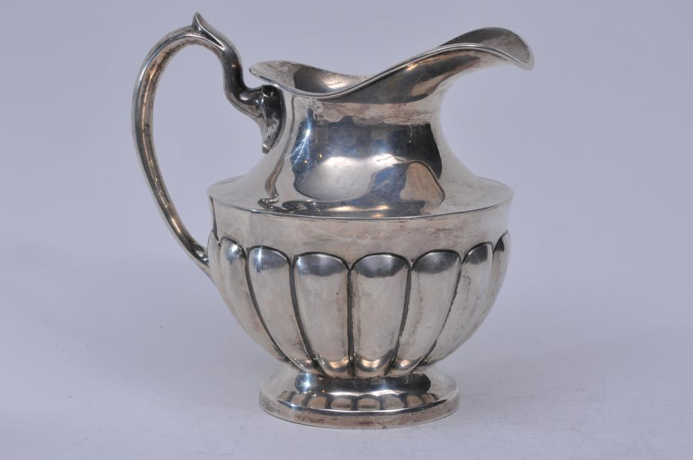 "Lot 184: Ortega. Mexico. Heavy sterling silver ribbed melon form pitcher. 8-1/4"" high. 34.6 ozt. Good condition."