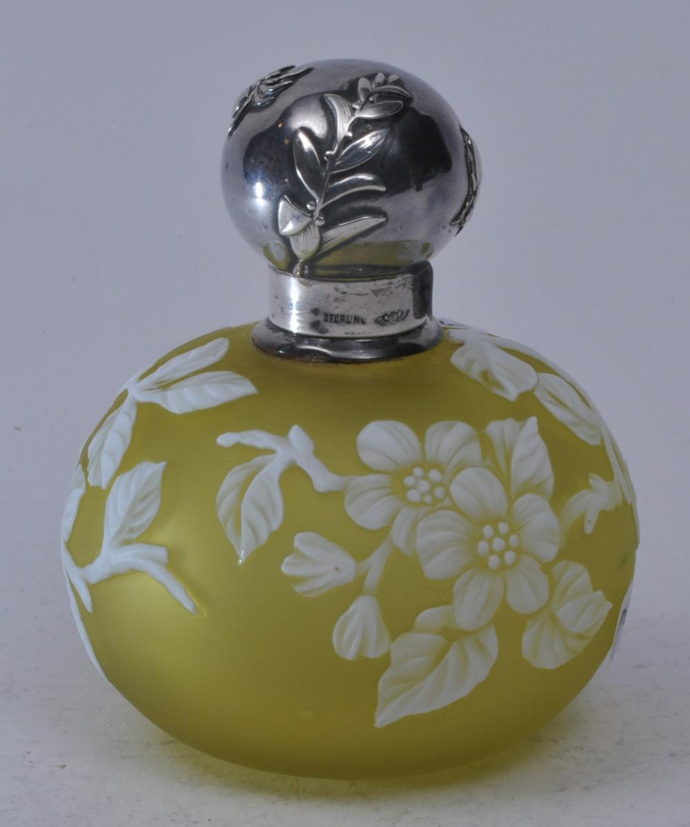 Webb Cameo Glass perfume bottle. ?? Base color. Chartreuse? With white cut flowers and branch decoration. Sheibler sterling silver relief and spider and fly decorated screw on top. Glass unmarked. Silver top with two small dents on silver base rim- 3