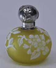 Lot 169: Webb Cameo Glass perfume bottle. ?? Base color. Chartreuse? With white cut flowers and branch decoration. Sheibler sterling silver relief and spider and fly decorated screw on top. Glass unmarked. Silver top with two small dents on silver base rim- 3