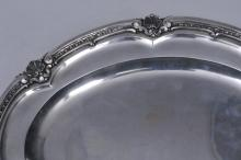 """Lot 185: Continental .800 silver oval tray with paneled body and raised shell decorated border. Hallmarked on rim. 14"""" x 11"""". 40.9 ozt."""