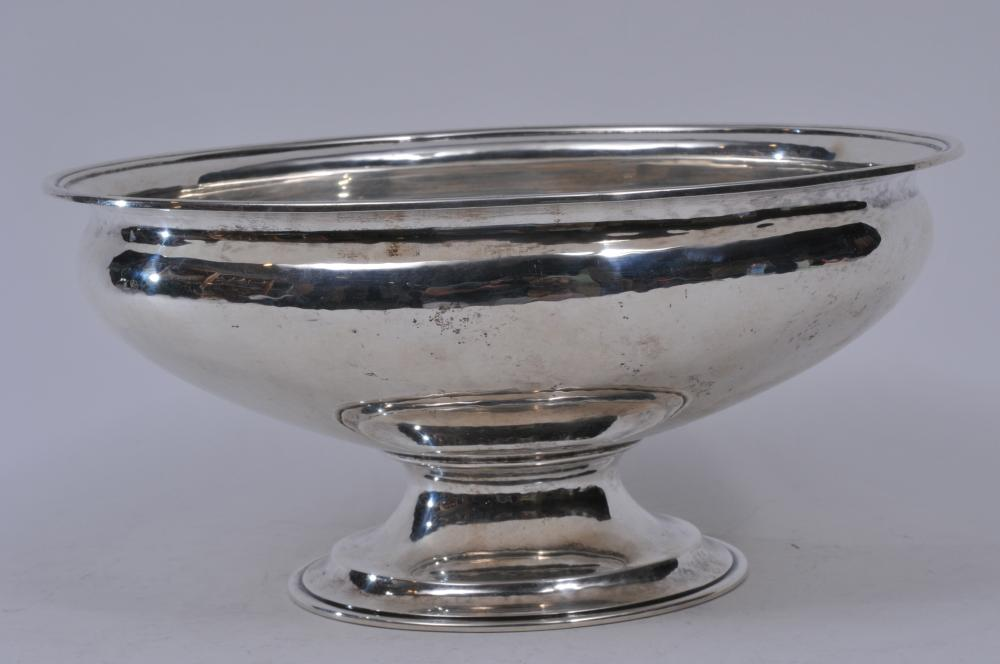 "Lot 145: Gyllenberg & Swanson large sterling silver footed bowl with moulded rim and base. Hand hammered surface. Good condition. Light scratches. 11"" diameter. 5-1/4"" high. 35.6 ozt."