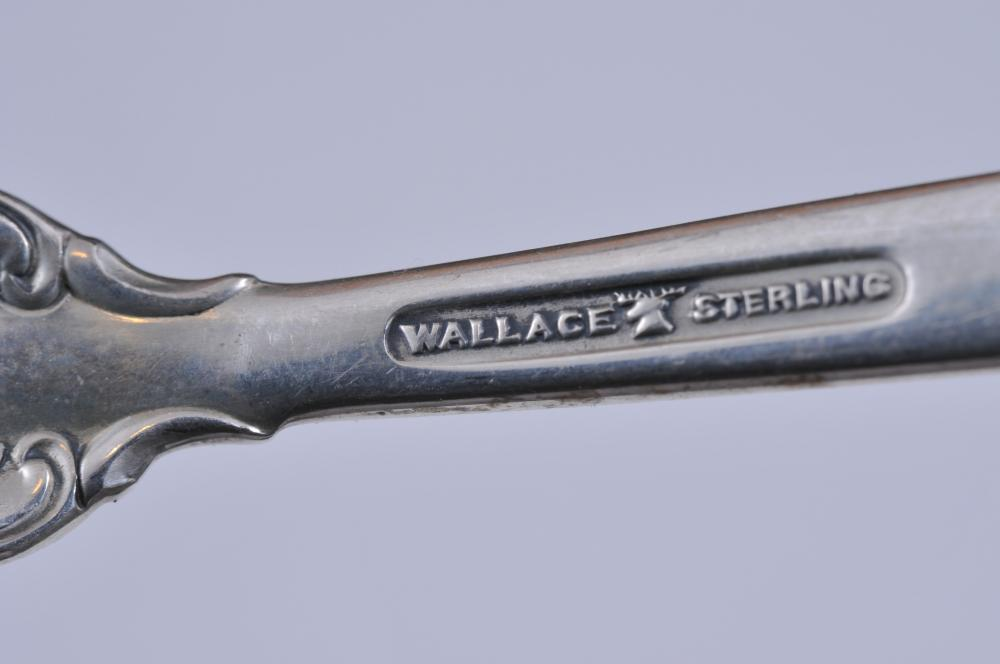 """Lot 199: Wallace """"Grand Baroque"""" sterling silver partial flatware set. Includes: (21) forks- 6-1/2"""". (3) solid butter knives. (5) knives- 8-7/8"""". Knives at 1 oz. each. 37.6 ozt total weight."""