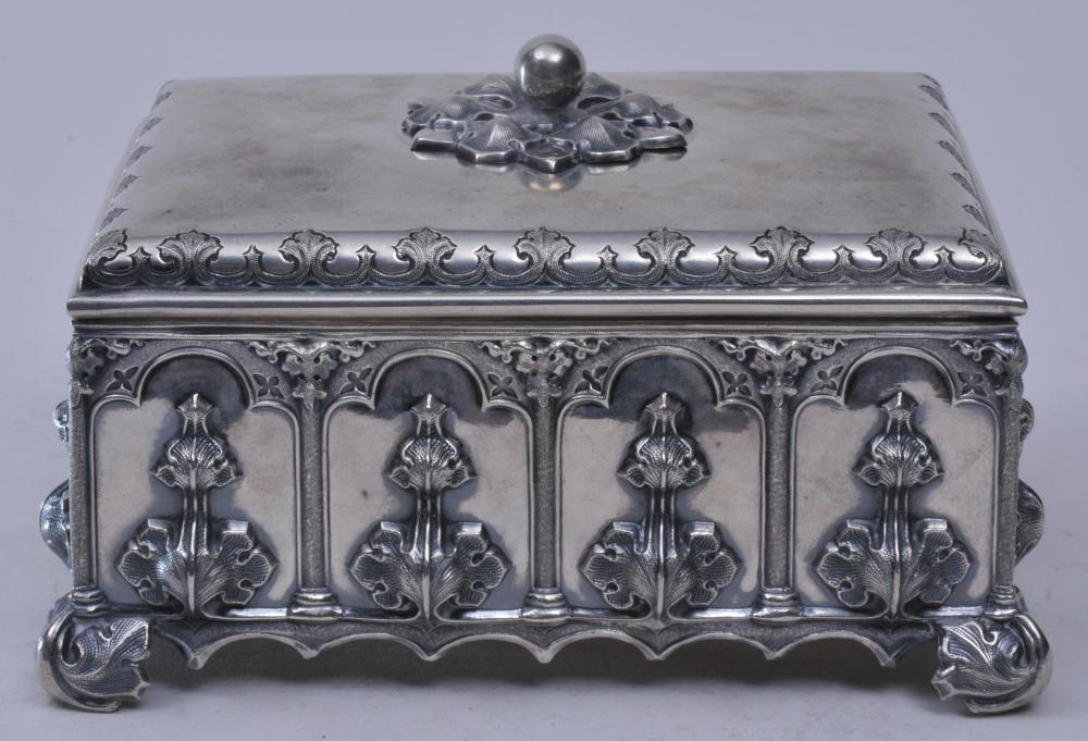 """19th century Continental silver Gothic decorated rectangular covered box. Gothic panels with raised leaf decoration. Leaf form feet. Cut out Gothic base. Engraved decoration. Unmarked. 6-1/2"""" wide. 3-3/4"""" high."""