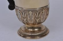 Lot 146: 19th century French gilt silver pot. Cardeilac. Paris. Figural mask spout. Chased and relief decoration. Stippled ground base. Ebonized wood handle. Cover with a lift top finial revealing opening to release steam. Hallmarked on base. Finial hallmarke