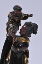 """Lot 165: Mixed Metal figure of a woman and child. Japan. Meiji period. (1868-1912). Miyako School. Signed on base and with a seal. 12"""" high."""