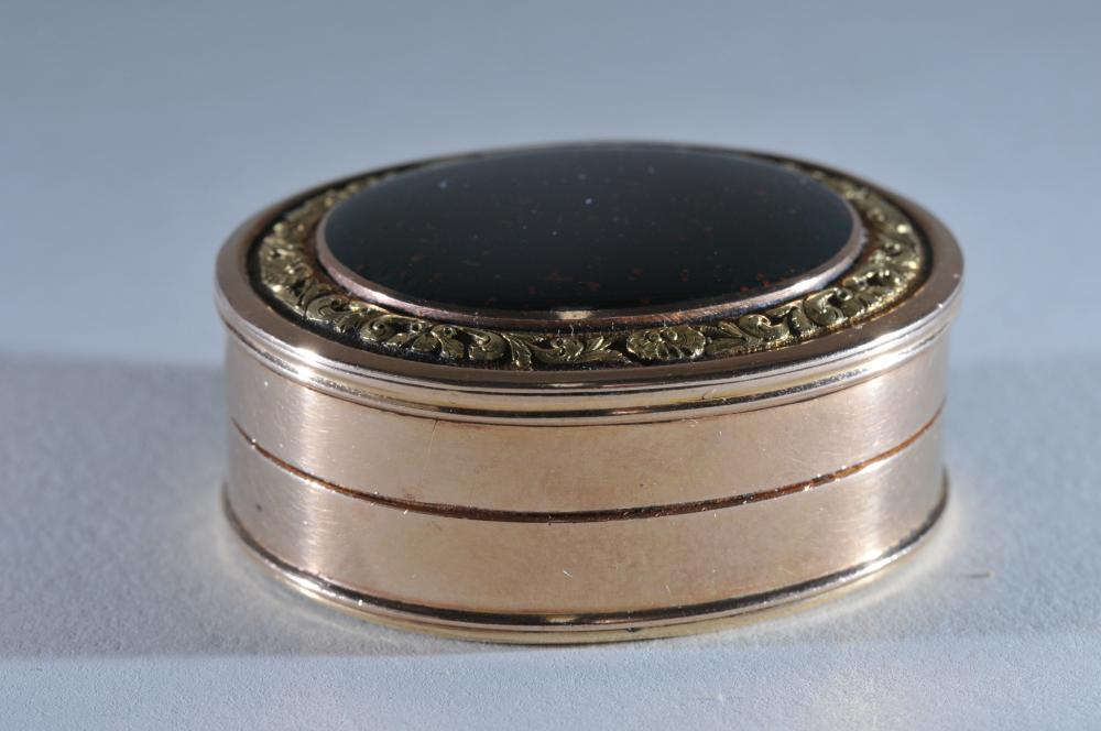 14 karat gold antique Bloodstone mounted oval gold vinaigrette. Bloodstone cover with shell and leaf border. Interior with floral pierced decorated hinged lid. Blood stone mounted base. Inscribed numbers are the only markings. Tested as 14 karat gol