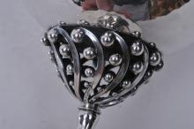 """Lot 172: Georg Jensen. Denmark. Sterling silver covered footed bowl with open work geometric decorated stem. Tear drop finial. 6"""" high. 5"""" diameter. 13.3 ozt. Good condition."""