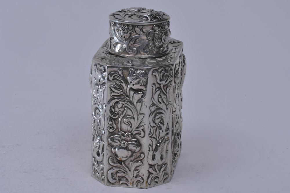 "Lot 171: 19th century Continental silver floral repousse decorated tea caddy. Octagonal shaped body with round cover. Hallmarked on base. 4-3/4"" high. 4"" wide. 7 ozt."