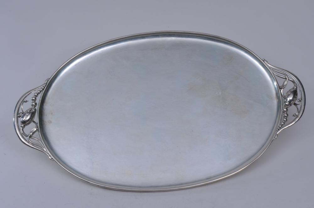"""Georg Jensen. Denmark. Sterling silver large Blossom pattern oval two handle tray. 22"""" x 13"""". Marked on underside. 55.5 ozt. Good condition."""