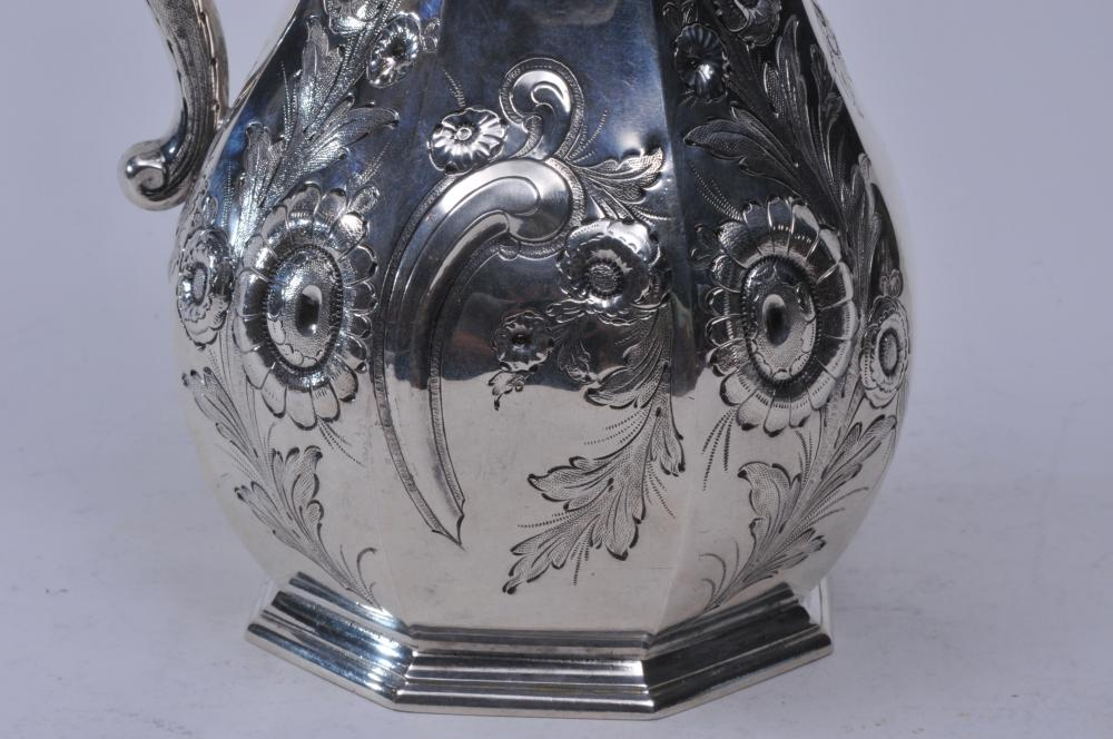 """Lot 166: Geradus Boyce. New York coin silver early 19th century coffee pot or ewer. Relief floral decoration. Octagonal form body. 9-3/4"""" high. 23.6 ozt. Good condition."""