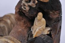 """Lot 174: Cabinet piece. Japan. Meiji period (1868-1912). Carved wood and bone. Scene of scholars in a mountain landscape. 7"""" x 5""""."""