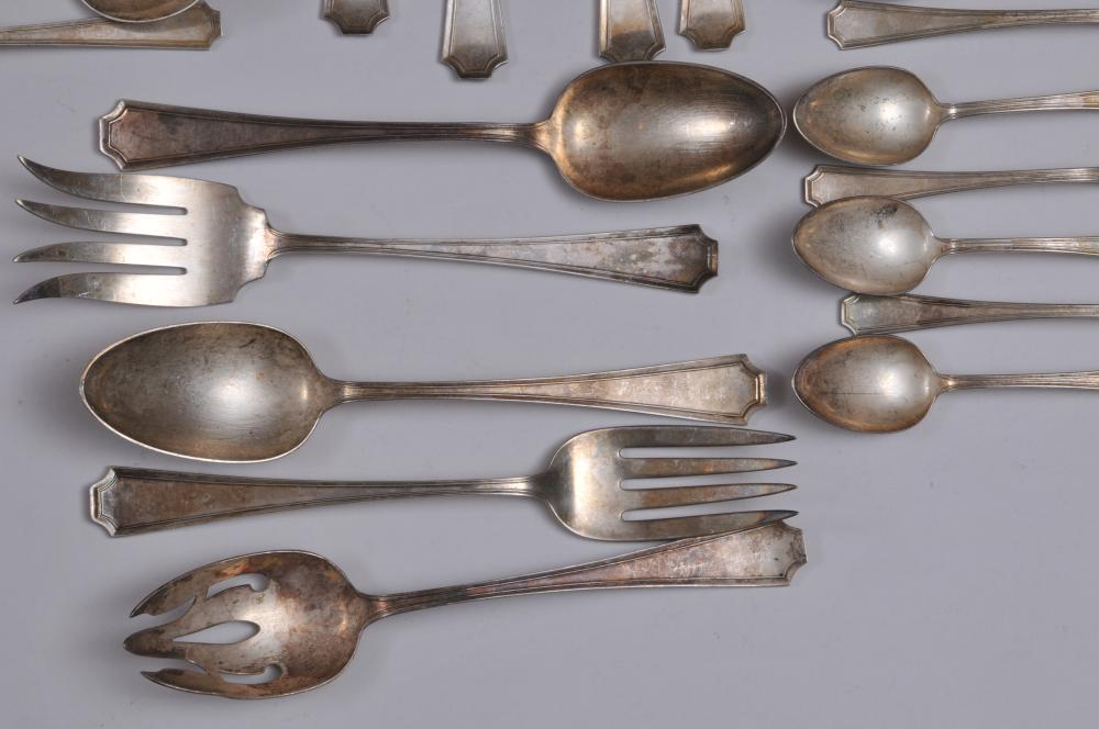 """Lot 176: Gorham """"Fairfax"""" pattern sterling silver 45 piece partial flatware set. Includes: (8) large forks- 8"""". (8) cream soup spoons- 6-1/4"""". (7) teaspoons- 5-3/4"""". (8)salad forks- 6-1/8"""". (7) seafood forks- 5-1/2"""". (3) large serving spoons. -one pierced bow"""