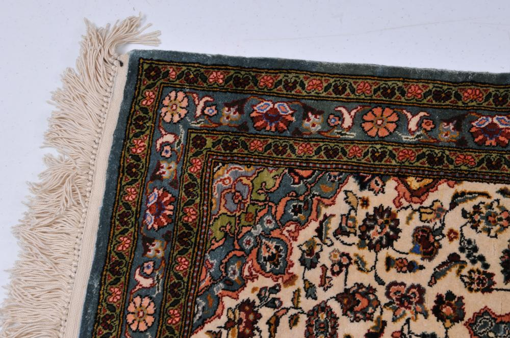 """Lot 193: Small silk Oriental carpet. White medallion with floral decoration. Good condition. 40"""" x 24"""" including fringe."""