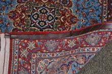 """Lot 195: 20th century fine quality Qum oriental carpet scatter rug. Sky blue field. Red medallion and borders. Fine condition. 67"""" x 43-1/2"""" overall."""