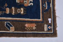 """Lot 194: 19th/20th century Chinese saddle bag carpet decorated with antiquities design. 49"""" x 23""""."""