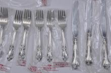 "Lot 203: Gorham sterling silver ""Melrose"" pattern 35 piece flatware set. New in original sealed plastic sleeve. Includes"" (7) forks- 6-1/2"". (8) forks- 7-1/4"". (8) teaspoons- 6"". (8) knives- 9"". (1) spreader. (1) scallop bowl spoon. Plus a two piece salad se"