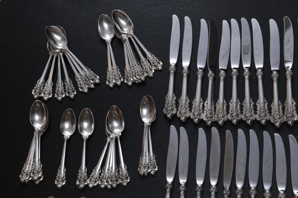 "Lot 201: Wallace ""Grand Baroque"" sterling silver large flatware set. 190 pieces. Includes: (24) forks- 7-1/2"". (24)forks- 6-1/2"". (24) cream soup spoons- 6"". (24) solid butter knives- 6-1/4"". (30) teaspoons- 6-1/8"". (24) seafood forks- 5-7/8"". (24) knives- 8-"