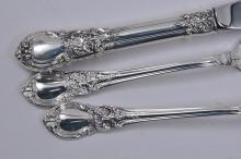 "Lot 204: Lunt sterling silver ""American Victorian"" pattern 42 piece flatware set. Still in the factory wrappings. Includes: (8) forks- 7-1/4"" , one fork missing wrap. (8) forks- 6-1/2"". (9) teaspoons- 6"". (8) tablespoons- 6-1/2"". (6) knives- 9"". (2) serving s"