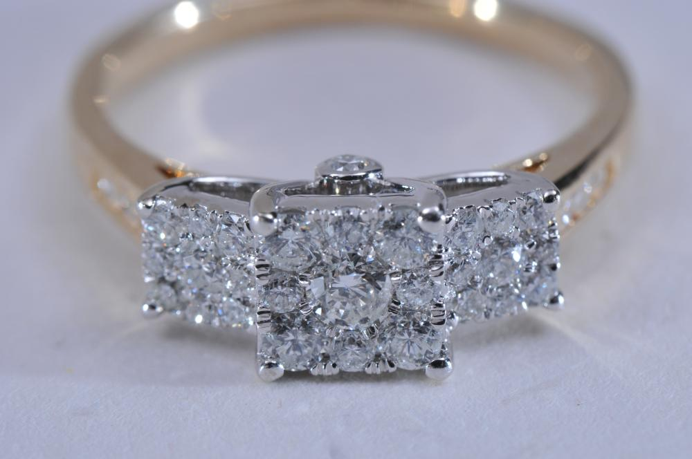 Lot 218: 14k yellow and white gold and diamond ring. Three-stone style, with diamond clusters. 29 round brilliant diamonds, near colorless. Finger size 7. Hallmarked 14k, total weight of 3.5g.