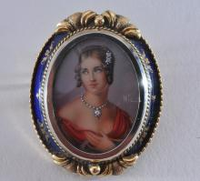 Lot 222: 18k yellow gold Italian portrait brooch/pendant. Overall size 41.5 x 33mm. Finely detailed image of a woman. Blue enamel border. Pin and bail present. 14.7g total weight. Hallmarked kt18 and Italy.