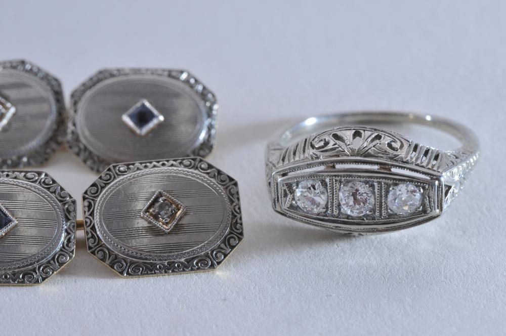 Lot 228C: Lot of 2 rings and cufflinks. Two platinum rings. One with 3 round brilliant diamonds (approx. 2.5mm each), one with 11 diamonds, mixed cuts and sizes. Round top ring is finger size 4.5, 3-stone ring is finger size 7. Cufflinks are 14k and platinum,