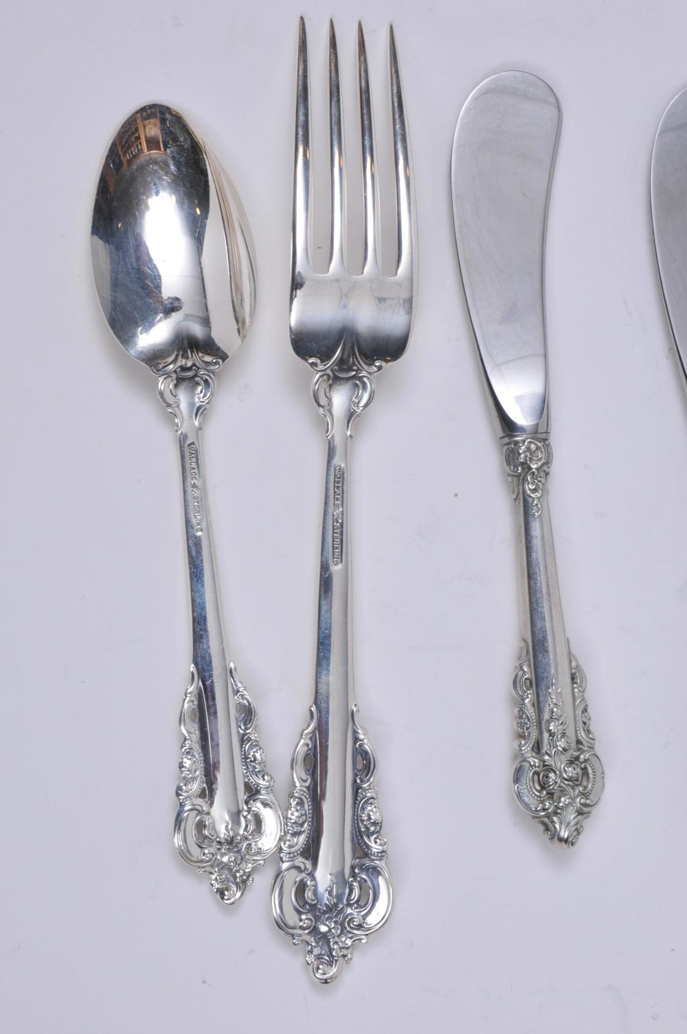 "Lot 230: Wallace ""Grand Baroque"" pattern sterling silver 38 piece flatware set. Includes: (8) forks- 7-1/2"". (8) forks- 6-1/2"". (8)teaspoons- 6-1/8"". (8) knives- 9"". (6) handled butter knives- 6"". Eight knife handles at 1. ozt each. Six knife handles at 1/3"
