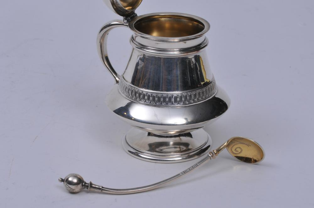 "Lot 236: Tiffany & Co. makers Victorian sterling silver mustard pot with oval geometric border. Gilt lined. 4-1/2"" high. Gilt bowl spoon with ball handle. Engraved bowl. Spoon marked Patent 1868 G.S. Sterling. Pot Union Square mark on base. Good condition. 5"