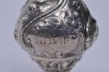 "Lot 235: 18th/19th century silver elaborately decorated salt shaker. Unmarked. 5-3/4"" high. 3 ozt."