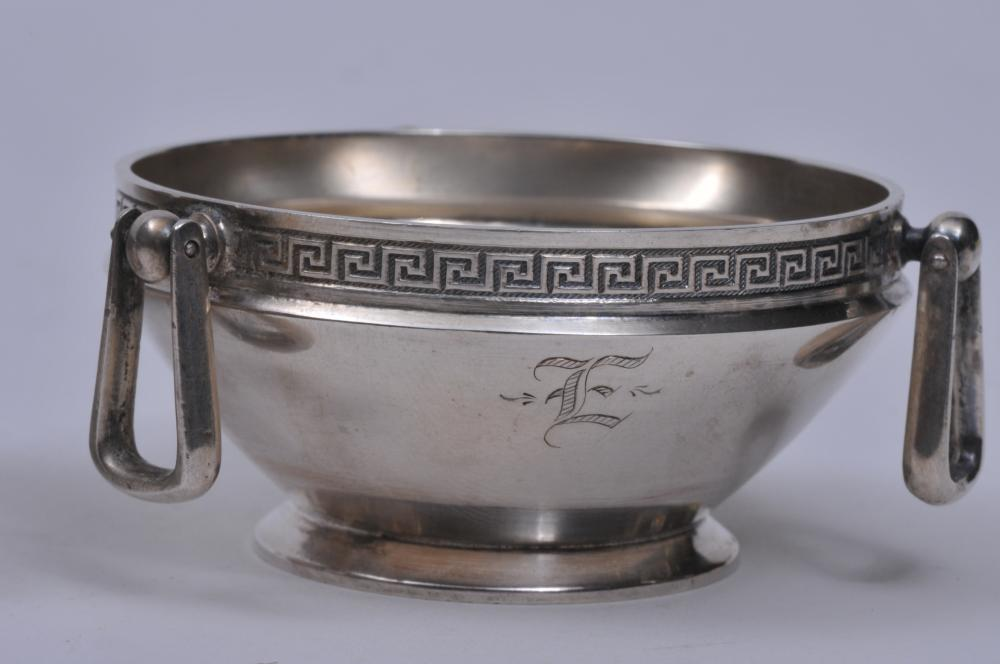"Lot 237: Pair of Gorham Victorian sterling silver round three swing handled master salts with Greek Key border. Marked on bases. Monogrammed. Very slight scratches on interior bases. Otherwise good condition. 2-2/3"" diameter. 3.7 ozt."