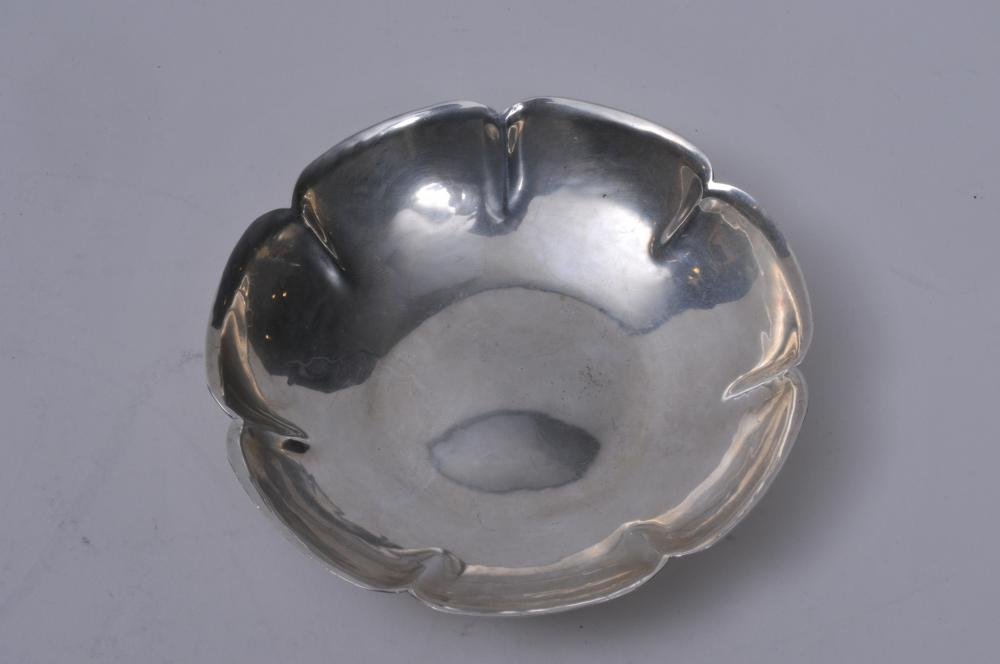 "Lot 242: ""Alfie"" sterling silver Arts and Crafts small lobed bowl with scalloped rim. Hand hammered surface. 4-1/2"" diameter. Good condition. 2.3 ozt."