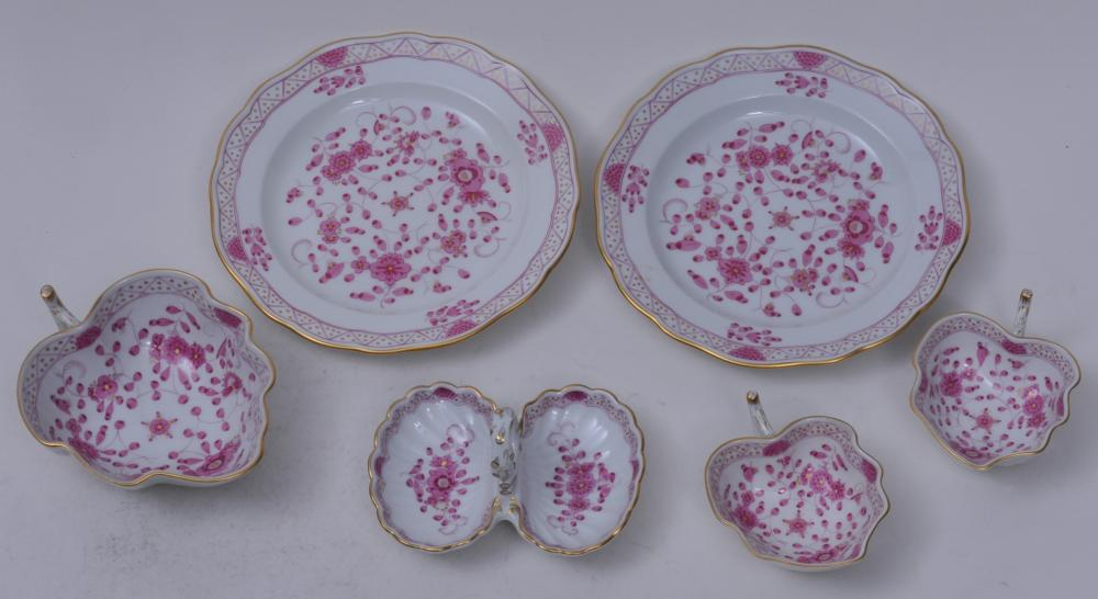 """Lot 248: Six Meissen porcelain puce floral decorated items. Three leaf shape cups. One divided handled small dish. Tow small plates- 6-1/4"""" diameter. Leaf cups with relief branch bases. All marked. Good condition."""