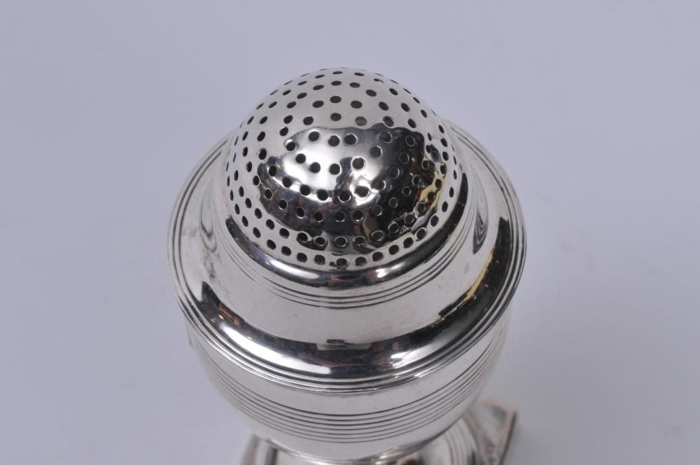 """Lot 240: 19th century English Georgian sterling silver salt shaker. Round body with line decoration. Square base. Marked on base rim. Good condition. London 1806-7 C.F. maker. Possibly Crespin Fuller. 4-1/4"""" high. 2.5 ozt."""