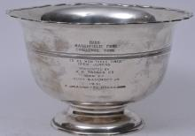 """Lot 250: Sterling silver 1930 Marshfield Fair Challenge Bowl trophy. Raised rim scallop top bowl. Presented to F. Jeanette McGregor. 1931. 9-1/4"""" diameter. 5-3/4"""" high. Dimples inside bowl bottom. 22.9 ozt."""