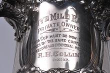 """Lot 249: Large ornate Gorham sterling silver three-handled trophy. Floral repousse decoration. """"Buick Trophy Presented by R.H. Collins. Kansas City Mo. Five Mile Race. June 15, 1912. Last winning date."""" Good condition. 13"""" high. 72.8 ozt."""