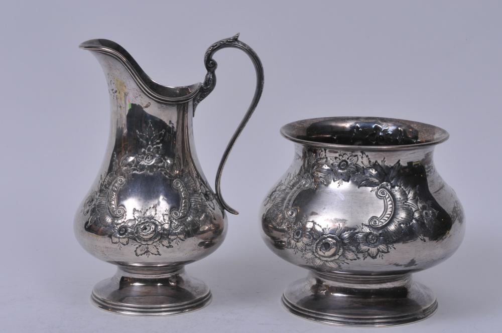 """Lot 253: Steiff sterling silver large creamer and sugar bowl. Floral repousse decoration. Creamer- 7-3/4"""" high. Good condition. 32.8 ozt."""