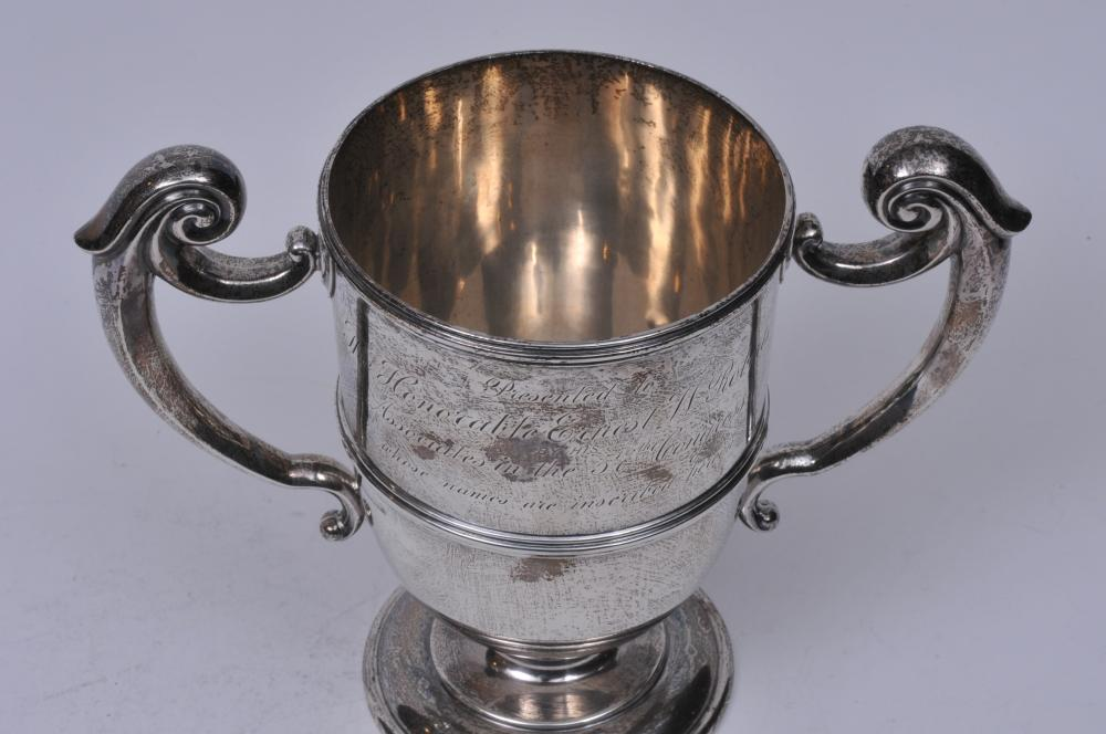 """Lot 251: Sterling silver two handled trophy presented to """"The Honorable Ernest W. Roberts by his associates in the 57th Congress"""". Names inscribed on back. Couple of small dimples on body. 10"""" wide. 8-1/4"""" high. 25.5 ozt."""