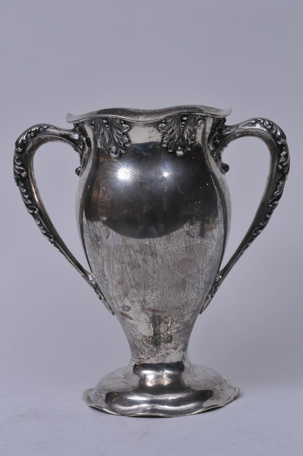 "Lot 256: Sterling silver two handled trophy. Scalloped top and base. ""Presented to Charles M. Maury by Fellow Members of The New York Stock Exchange 1901"". Good condition. 11"" high. 10-1/2"" wide. 41.5 ozt."