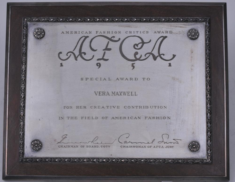 "Lot 264: Cartier sterling silver and wood presentation plaque. ""American Fashion Critics Award. Special award to Vera Maxwell"". 8-3/4"" x 10-1/2""."
