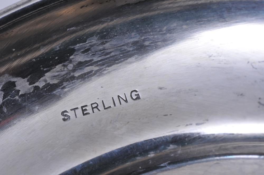 """Lot 262: Sterling silver two handled trophy. """"Presented to Ex Chief L.E. Pattison by members of The Webster Fire Dept. May 16, 1906"""". A couple of dimples. Crease near inscription. Top rim bent. 12-1/4"""" high. 24.5 ozt."""