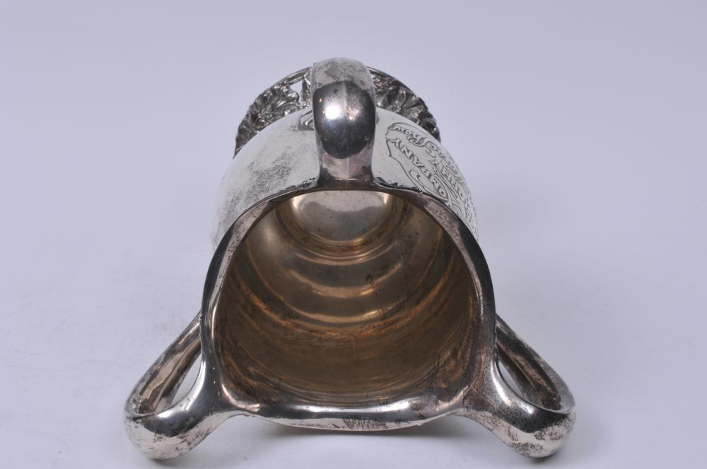 "Lot 261: Large LeBolt sterling silver Arts and Crafts three-handled trophy. Arts and Crafts inscription and ornate raised floral decoration. ""LeBolt Company Trophy- Chicago Horse Show. 1902. Won by G.W. Nixon's Maud"". Good condition. 11-3/4"" high. 11"" wide."