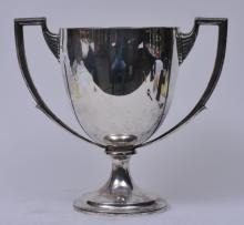 """Lot 277: English sterling silver two-handled trophy. """"Lake Hopatcong Yacht Club"""" """"Perpetual Trophy"""". New Jersey State Championship 135 Cubin Inch Class. Enameled red flag and anchor decoration. Hallmarked on body near handle. London 1911-12. Crichton Bros. N"""