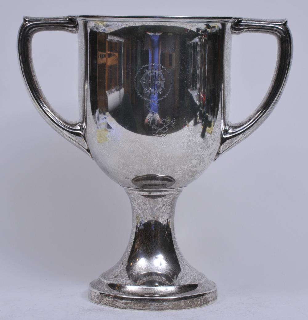"""Lot 281: Large Gorham sterling silver two-handled trophy. """"Presented to Captain Edward R. Geer. Superintendent of The Cape Cod and New York Canal Co. 1917"""". Decorated with Geer monogram and anchor and chain on reverse. 14"""" high. 13-1/2"""" wide. Small dent on ba"""