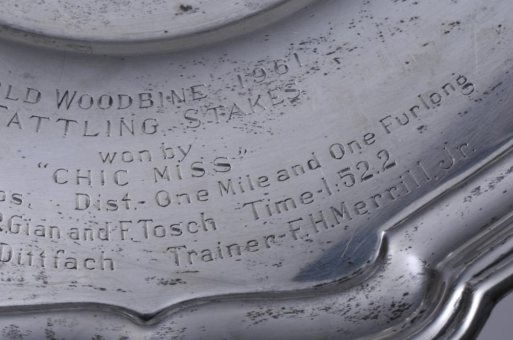"""Lot 272: Sterling silver Presentation tazza. """"Old Woodbine 1961 Tattling Stakes won by """"Chic Miss"""". The Jockey Club"""". 10"""" diameter. 3"""" high. 13.2 ozt."""