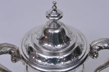 "Lot 276: Reed and Barton sterling silver covered two handled trophy. Raised leaf and vine design. ""Board of Governors Trophy. The Traffic Club of New York"" ""Three time Winner J.F. Turf"" 1945 Last date. 13-1/2"" high. Good condition. 45.7 ozt."
