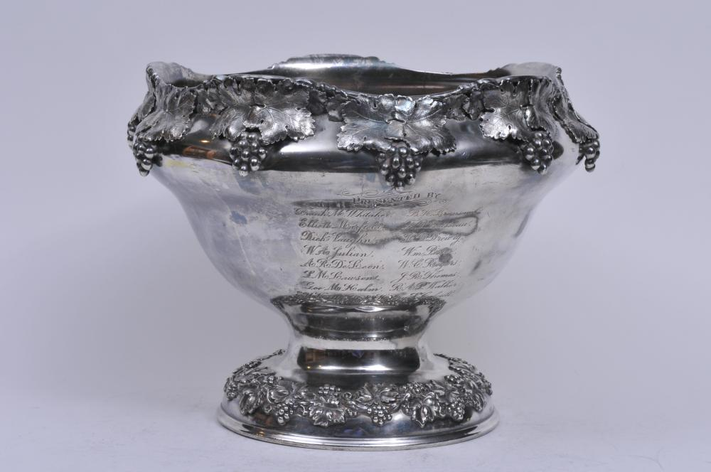 """Lot 282: Large Roman Silver-plate Co. ornate grape leaf and vine decorated punch bowl trophy. """"The Nock Eins Bowl"""". Presented to Mr. & Mrs. Thornton Lewis. Founders of The Greenbrier Country Horse Show. The Meadows. White Sulphur Springs, W. Va. Wear to silve"""